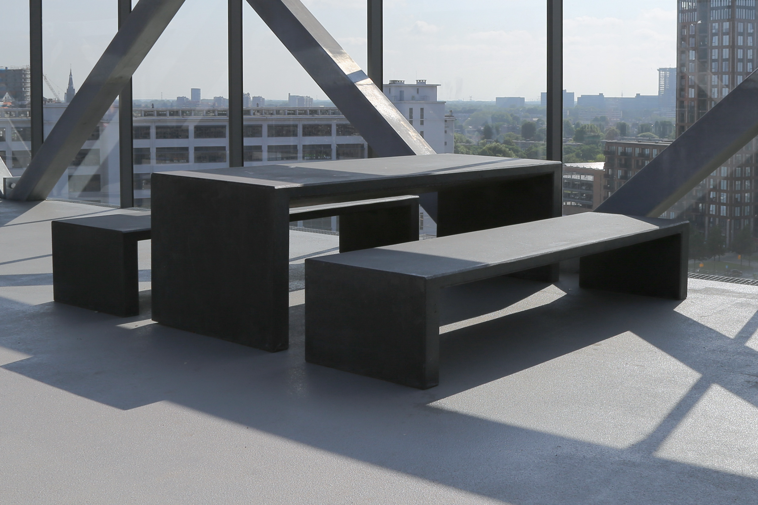 Black picnic tables from the terrace of the Klokgebouw building, the Netherlands.