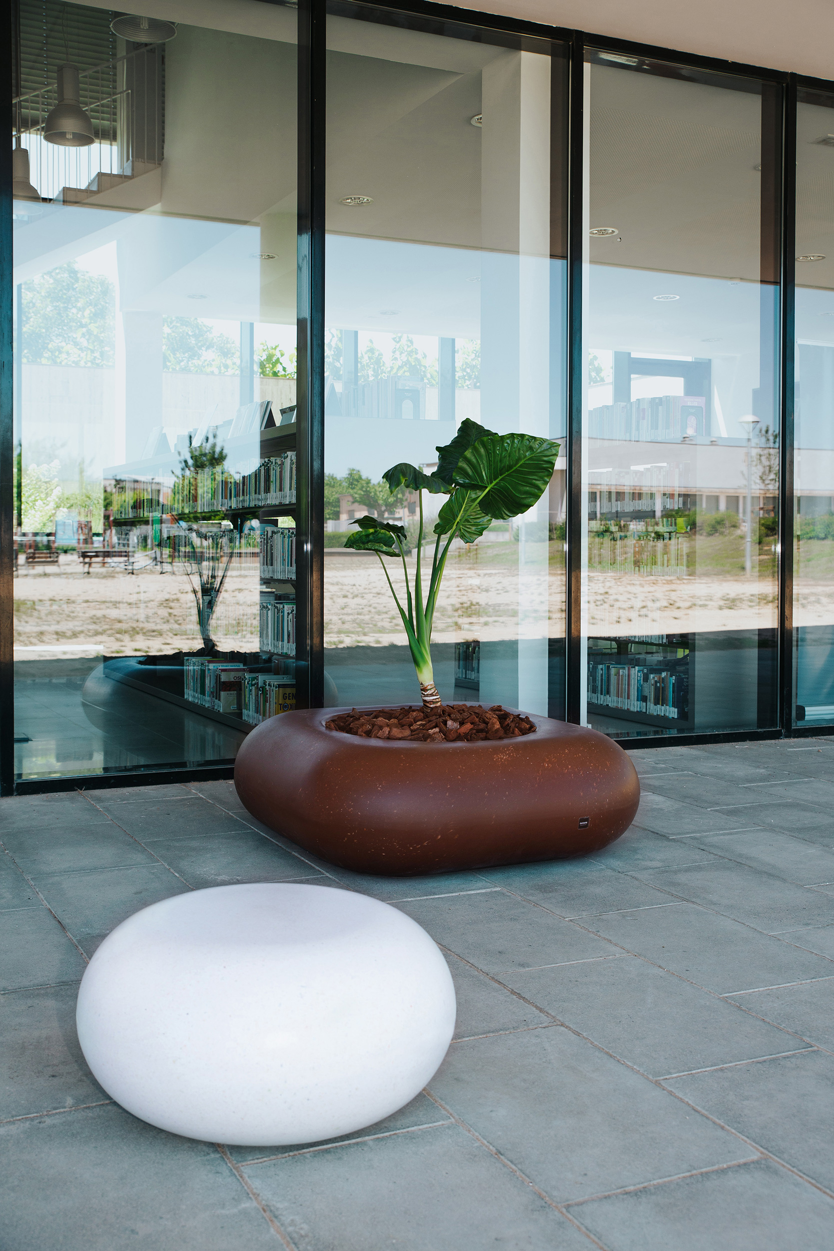 Recycled plastic planter, made by Durbanis, in front of the Porqueres library, Catalunya, Spain