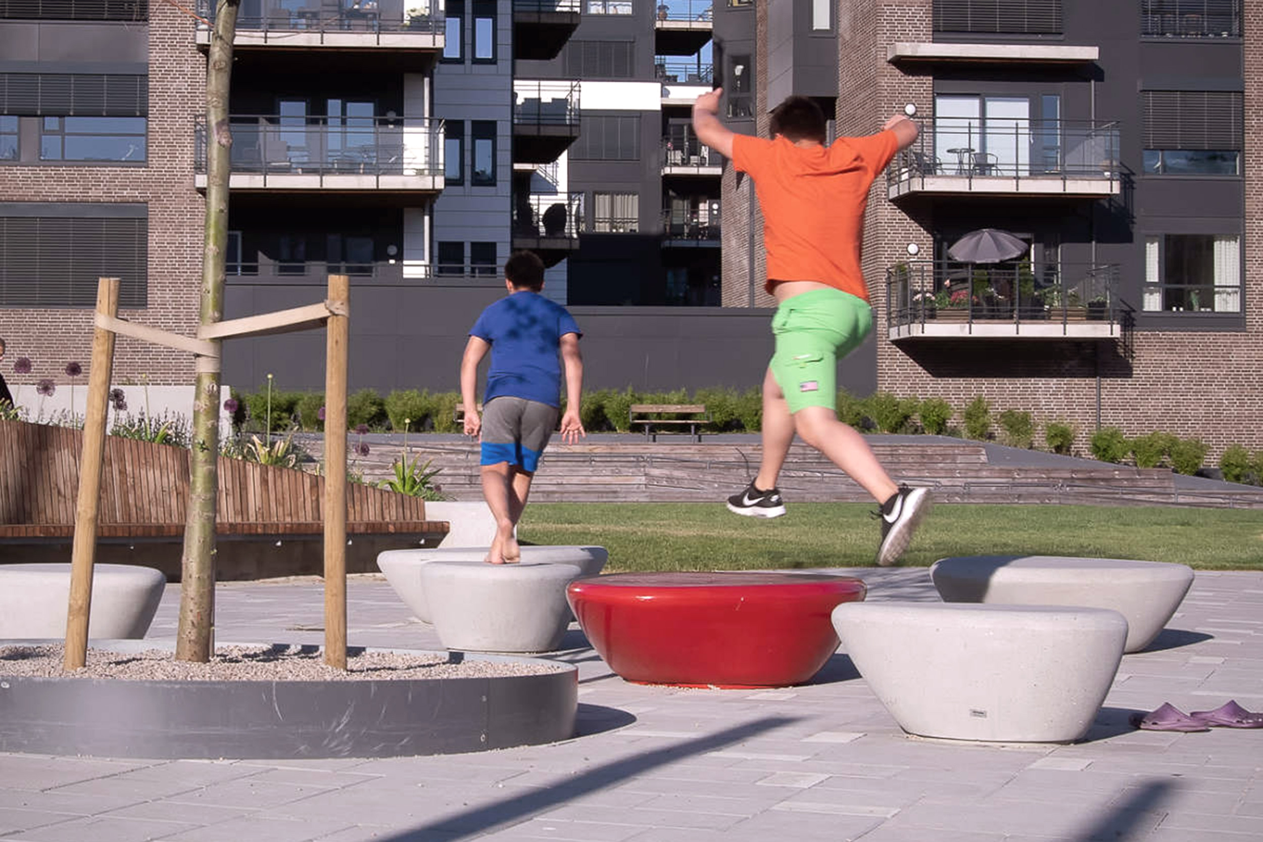 Children playing parkour at the Arendal park in Norway