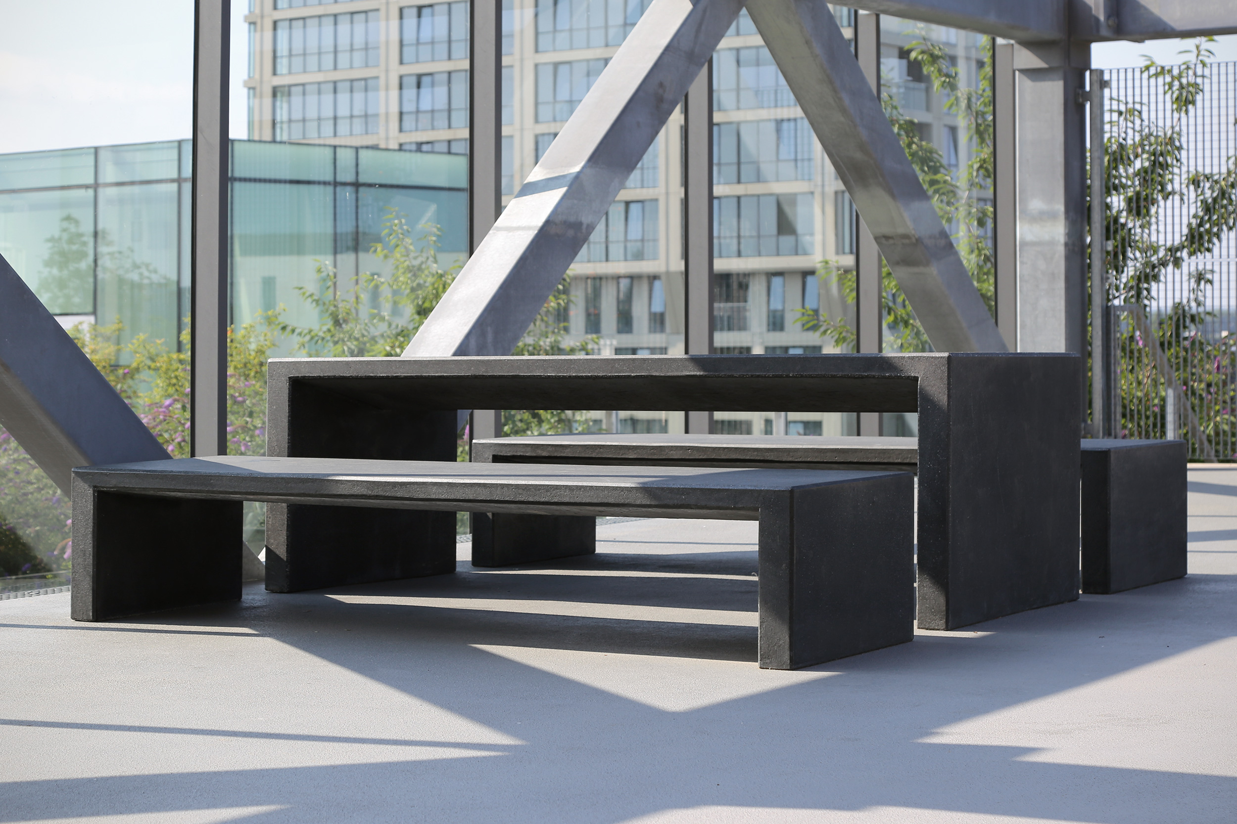 Set of black concrete benches and tables from Durbanis.