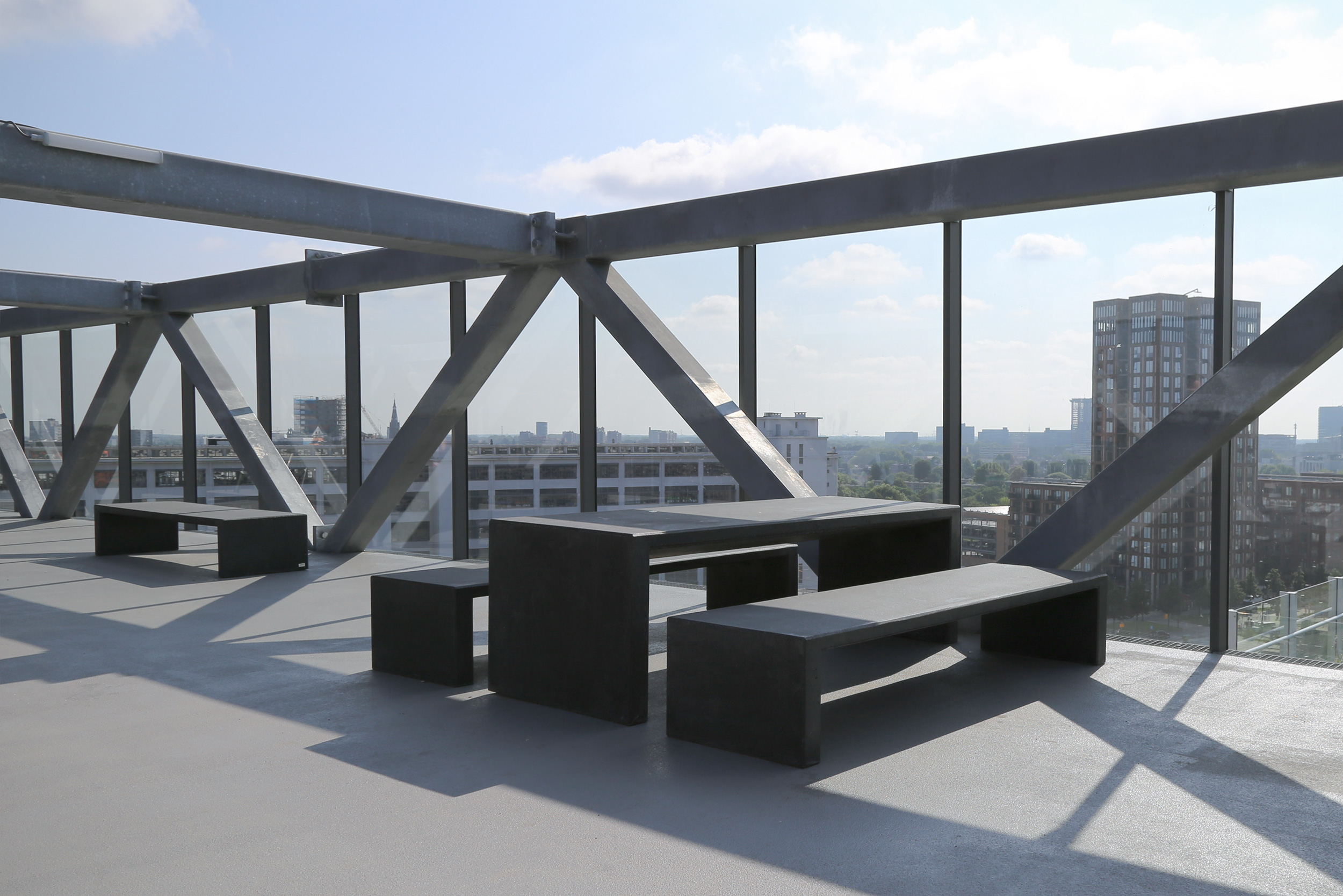 Klokgebouw building with its terrace facing Eindhoven. Benches and tables by Durbanis design firm.